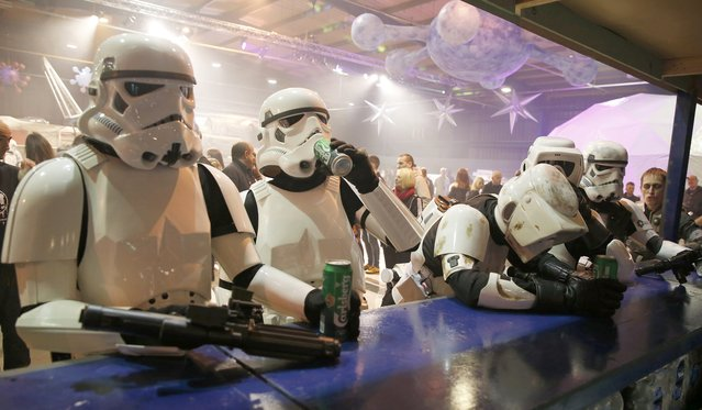 People dressed as Storm troopers stand at a bar as they pose for a photograph holding cans of beer at the  'For The Love of The Force' Star Wars fan convention in Manchester, northern England, December 4, 2015. (Photo by Phil Noble/Reuters)