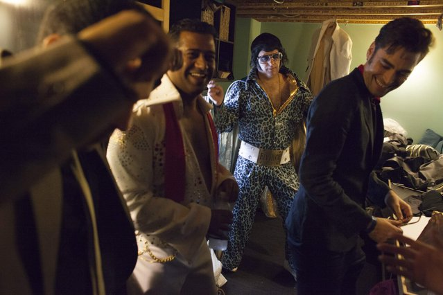 Participants joke around and dance backstage during the 20th annual Seattle Invitationals, an amateur Elvis impersonator competition, in Seattle, Washington January 23, 2015. (Photo by David Ryder/Reuters)