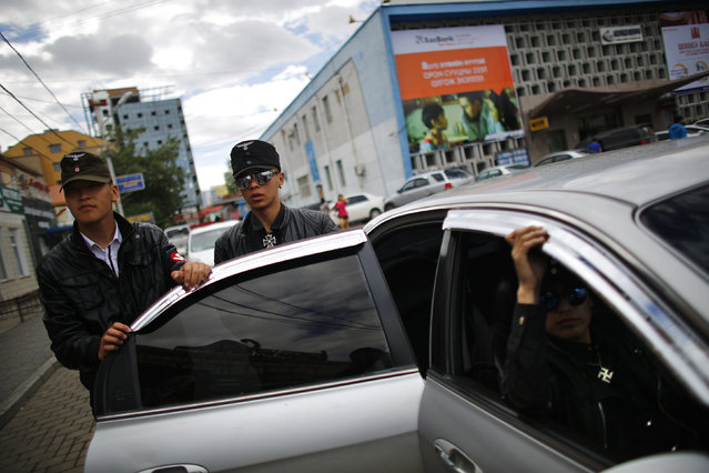 Members of the Mongolian neo-Nazi group Tsagaan Khass leave their headquarters in Ulan Bator June 23, 2013. (Photo by Carlos Barria/Reuters)