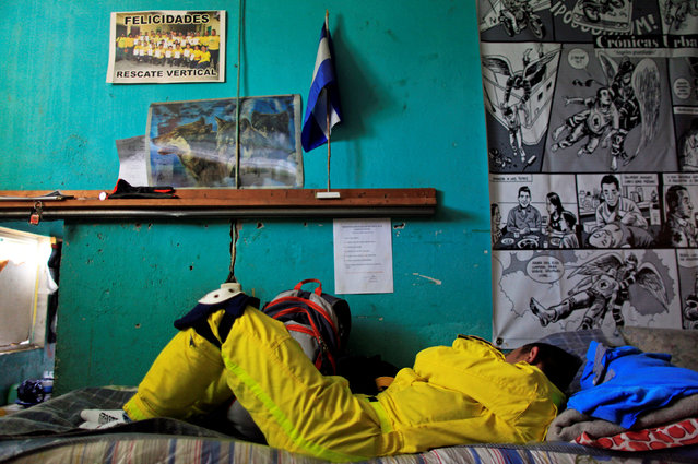 A rescue worker sleeps after the night shift at the Comandos de Salvamento base in San Salvador, El Salvador July 2, 2016. In 2015, El Salvador registered a record 103 homicides per 100,000 habitants, making it one of the most dangerous countries in the world outside a war zone. But for many young people who have few chances to distance themselves from rivalries between so-called maras in their schools and neighbourhoods, a civil-society organisation called the Comandos de Salvamento, or Rescue Corps, has been a refuge. Jhonny Ramos, a volunteer coordinator, said that about 2,000 youths now respond to traffic accidents, natural disasters and violent crimes in a country where emergency services personnel have been overwhelmed by crises. The volunteers, who are trained in first-aid, gunshot wound care and evacuation techniques, often spend long shifts  sleeping on small cots and responding to emergency calls. With 32 bases around the country, the organisation founded 56 years ago has also helped to take many youth off the country's crime-ridden streets and offering them opportunities to work as yellow-clad outreach workers. (Photo by Jose Cabezas/Reuters)