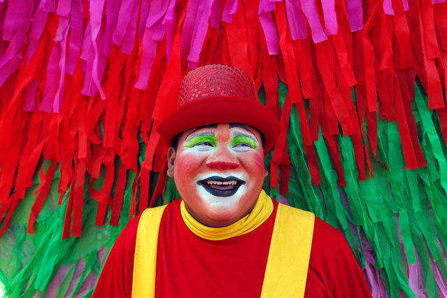 A clown poses for a portrait on the waterfront of Xolotlan Lake in Managua, Nicaragua, November 4, 2016. (Photo by Oswaldo Rivas/Reuters)