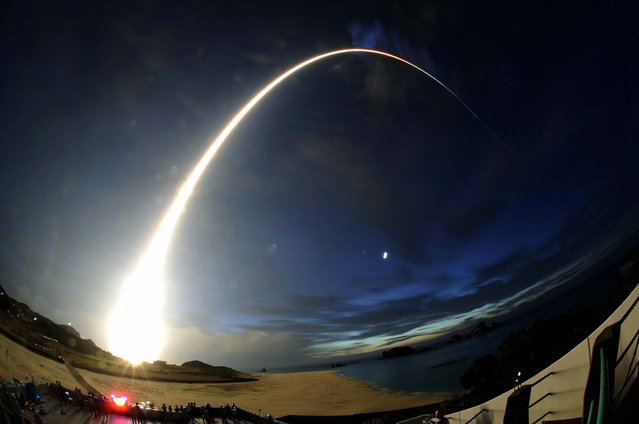 A H-2B rocket carrying cargo for the International Space Station blasts off from the launching pad at Tanegashima Space Center on the Japanese southwestern island of Tanegashima, on August 4, 2013. (Photo by Kyodo/Reuters)