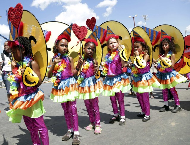 Revellers from the band Emoji wait to go on stage at the annual Trinidad and Tobago Red Cross Society's children's carnival competition at the Queen's Park Savannah in Port-Of-Spain February 7, 2015. (Photo by Andrea De Silva/Reuters)