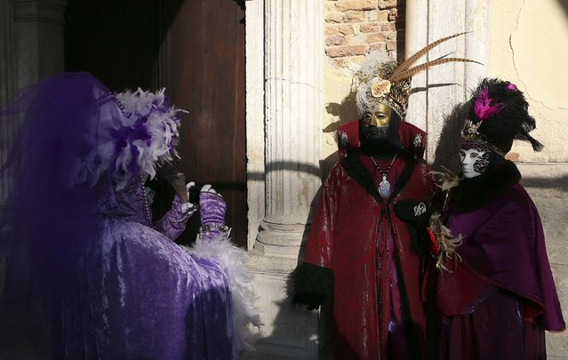 Masked revellers have their picture taken in St. Mark's Square during the Venice Carnival, February 7, 2015. (Photo by Stefano Rellandini/Reuters)