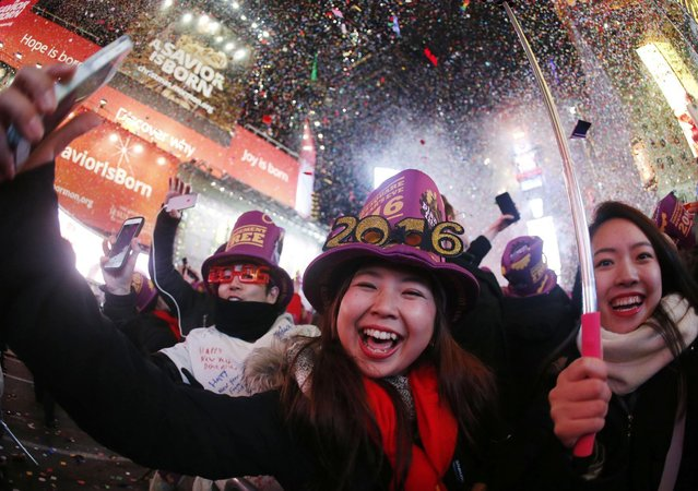 Revelers ring in the new year at Times Square, Friday, January 1, 2016, in New York. (Photo by Julio Cortez/AP Photo)
