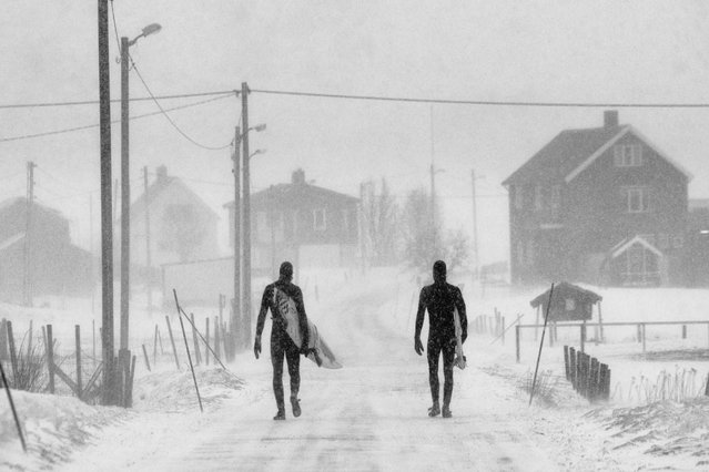 """A shot of two surfers making their way home in the snow was captured by photographer Chris Burkhard to take first place in the """"Spirit"""" category. (Photo by Chris Burkhard/Red Bull)"""