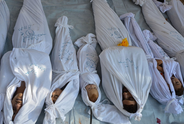 Bodies of people activists say were killed by nerve gas in the Ghouta region are seen in the Duma neighborhood of Damascus, Syria, August 21, 2013. Syrian activists said at least 213 people, including women and children, were killed in a nerve gas attack by President Bashar al-Assad's forces on rebel-held districts of the Ghouta region, east of Damascus. (Photo by Bassam Khabieh/Reuters)