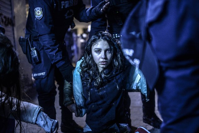 Bulent Kilic, a Turkish photographer for Agence France-Presse, won the First Prize in the Spot News Category, Singles, of the 2015 World Press Photo contest with this picture of a young girl after she was wounded during clashes between riot police and protesters following the funeral of Berkin Elvan, the 15-year-old boy who died from injuries suffered during last year's anti-government protests in Istanbul, in this picture taken March 12, 2014 and released by the World Press Photo on February 12, 2015. (Photo by Bulent Kilic/AFP Photo/World Press Photo)