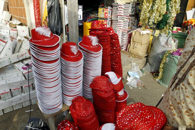 Christmas hats and decorations are seen on display at a store on the eve of Christmas at Wuse market in Abuja, Nigeria December 24, 2015. (Photo by Afolabi Sotunde/Reuters)