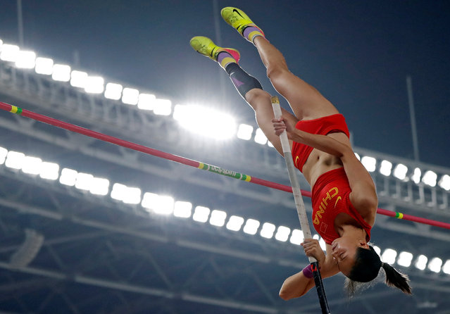China' s Li Ling competes in the final of the women' s pole vault athletics event during the 2018 Asian Games in Jakarta on August 28, 2018. (Photo by Issei Kato/Reuters)