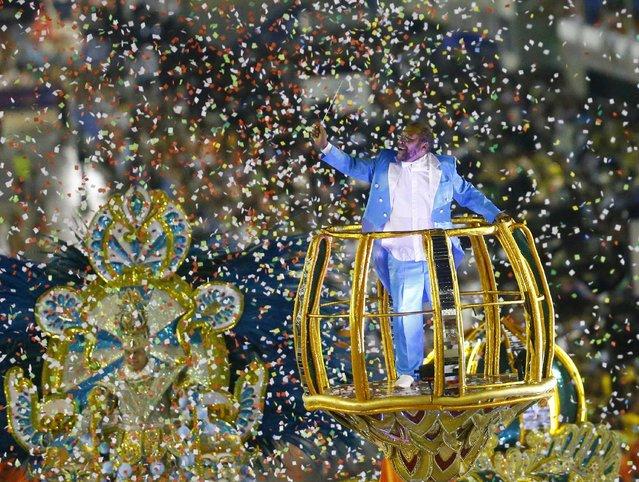 Brazilian singer Martinho da Vila parades with Vila Isabel samba school in the annual carnival parade in Rio de Janeiro's Sambadrome, February 16, 2015. (Photo by Ricardo Moraes/Reuters)