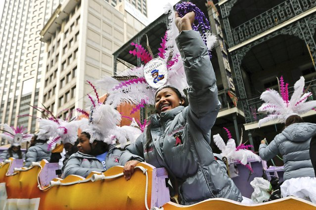 A member of the Zulu Social Aid and Pleasure Club throws beads on Mardi Gras in New Orleans, Louisiana February 17, 2015. (Photo by Jonathan Bachman/Reuters)
