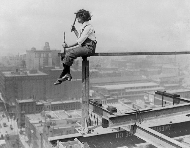 """After finding the bricklaying business too full of ups and downs, this amazing young girl decided to take a shot at iron girdering for a change. She is Miss """"Collie"""" Collier, a reporter for the Chicago Herald-Examiner. August 17, 1920. (Photo by Bettmann Archive/Getty Images)"""