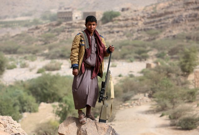 A tribal fighter loyal to Yemen's government poses for a picture in Al Khurais village of Nihm district east of the capital Sanaa January 11, 2016. (Photo by Ali Owidha/Reuters)