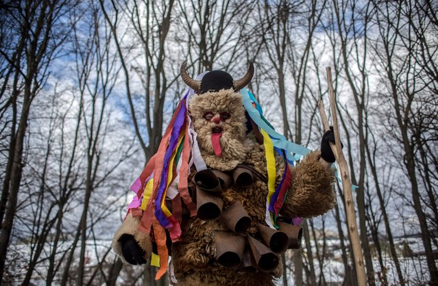 A participant dressed in a traditional devil costume walks from house to house during the traditional St. Nicholas parade on December 3, 2016 in village of Francova Lhota, Czech Republic. This type of parade is one of the most popular age-old traditions in a few villages in the Wallachia region of Eastern Czech Republic. St. Nicholas and company roam the streets going from house to house, for two or three days as St. Nicholas gives sweets and tiny gifts as a present to children and the devils get up to mischief. (Photo by Matej Divizna/Getty Images)