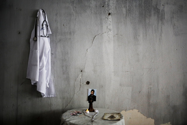 A photograph of Saint Josephine Bakhita, who was a Sudanese-born former slave, and a hospital gown, belonging to a student who is among members of lesbian, gay, bisexual and transgender (LGBT) community, that have been invited to live in a building that the roofless movement has occupied, hang on a wall, in downtown Sao Paulo, Brazil, November 26, 2016. (Photo by Nacho Doce/Reuters)
