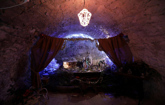 A Nativity scene is seen in a barn in the medieval mountain village of Luceram as part of Christmas holiday season, France, December 15, 2016. (Photo by Eric Gaillard/Reuters)