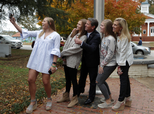 Georgia Republican gubernatorial candidate Brian Kemp poses for a photo with his family after voting Tuesday, November 6, 2018, in Winterville, Ga. Kemp is in a close race with Democrat Stacey Abrams. (Photo by John Bazemore/AP Photo)
