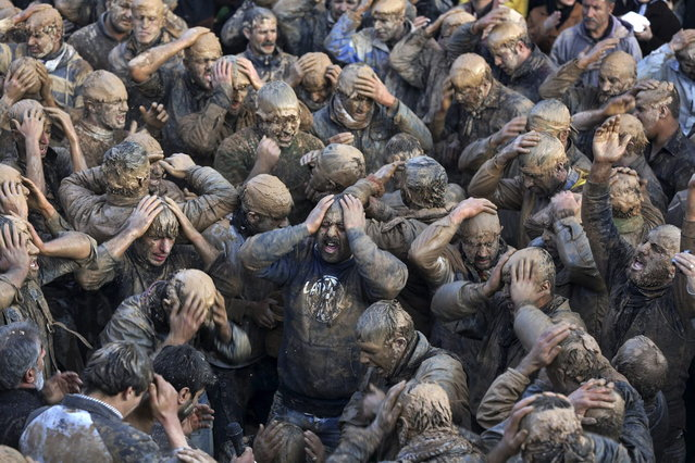 Iranian mourners cover themselves with mud during Ashoura, marking the death anniversary of Imam Hussein, the grandson of Islam's Prophet Muhammad, at the city of Bijar, west of the capital Tehran, Iran, Thursday, November 14, 2013. (Photo by Ebrahim Noroozi/AP Photo)
