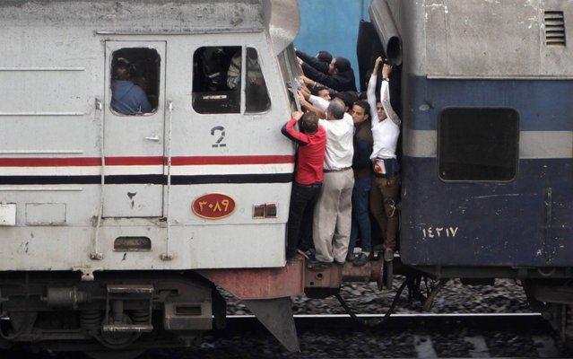 Passengers on a crowded train in Cairo, capital of Egypt, on November 18, 2013. (Photo by Mohamed Abd El Ghany/Reuters)