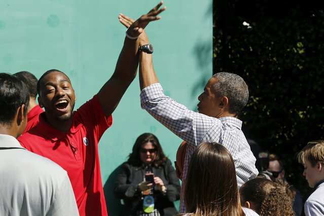 U.S. President Barack Obama (R) plays basketball with John Wall (L) of the NBA's Washington Wizards, during an exercise activity during the annual Easter Egg Roll at the White House in Washington April 6, 2015. (Photo by Jonathan Ernst/Reuters)