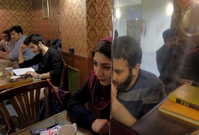 Iranian youths sit at a coffee shop in central Tehran, Iran February 14, 2016. (Photo by Raheb Homavandi/Reuters/TIMA)