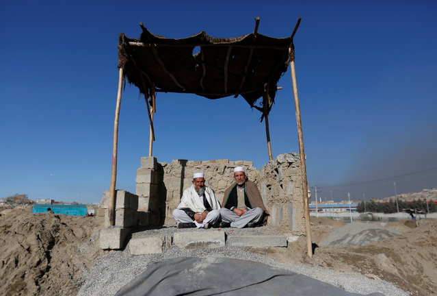 Afghan men sit in the sun during winter on a cold day in Kabul, Afghanistan January 8, 2017. (Photo by Mohammad Ismail/Reuters)