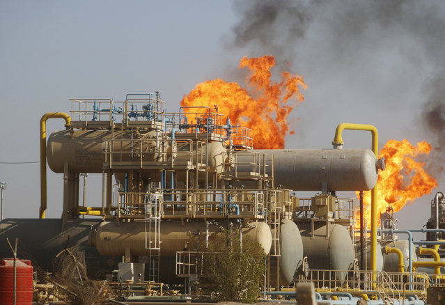 Flames emerge from a pipeline at the oil fields in Basra, southeast of Baghdad, Iraq October 14, 2016. (Photo by Essam Al-Sudani/Reuters)