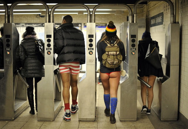 Some riders enter the New York subway in their underwear as they take part in the 2014 No Pants Subway Ride on January 12, 2014. (Photo by Timothy Clary/AFP Photo)