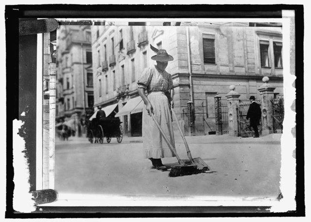 A woman street worker sweeps a street in Germany, circa 1909-1920, in this Library of Congress handout photo. (Photo by Reuters/Bain Collection/Library of Congress)