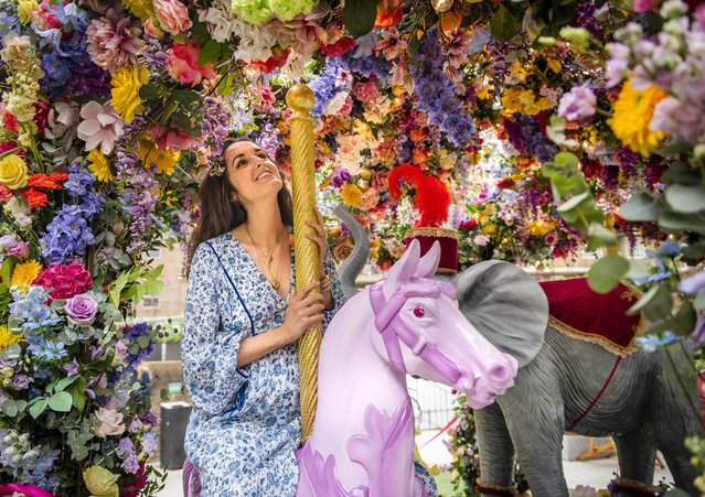 Competition judge, Rosanna Falconer looks at a floral carousel installation in Halkin Arcade on Monday, September 2021, which has been designed by florists Neill Strain and Judith Blacklock for the Belgravia in Bloom festival, running from September 20-26, London. (Photo by John Nguyen/PA Wire Press Association)