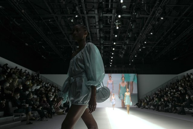 A model wears a creation for the Emporio Armani Spring Summer 2022 collection during Milan Fashion Week, in Milan, Italy, Thursday, September 23, 2021. (Photo by Luca Bruno/AP Photo)