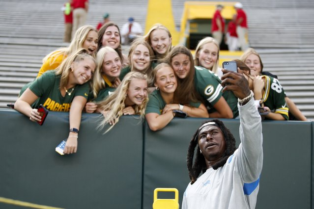 Detroit Lions' Jamaal Williams takes a selfie with fans before an NFL football game against the Green Bay Packers Monday, September 20, 2021, in Green Bay, Wis. (Photo by Matt Ludtke/AP Photo)