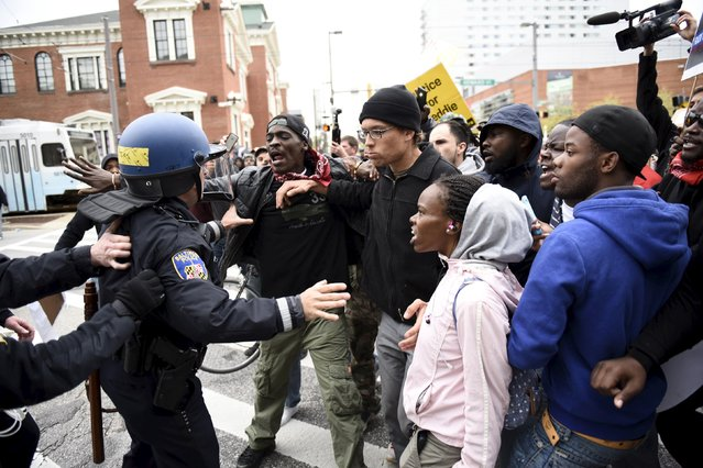 Police face demonstrators who gathered near Camden Yards to protest against the death in police custody of Freddie Gray in Baltimore April 25, 2015. (Photo by Sait Serkan Gurbuz/Reuters)