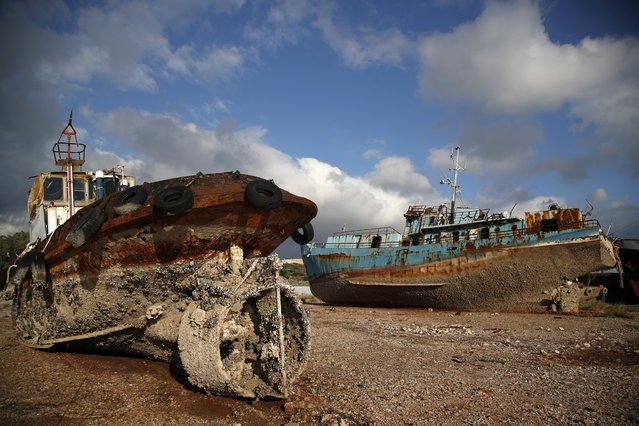 In this Wednesday, December 19, 2018 photo, small boats, that were recovered after spending years as shipwrecks are photographed at a dock in Elefsina, west of Athens. (Photo by Thanassis Stavrakis/AP Photo)
