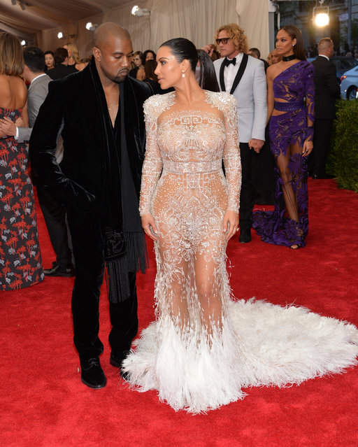 "Kanye West, left, and Kim Kardashian arrive at The Metropolitan Museum of Art's Costume Institute benefit gala celebrating ""China: Through the Looking Glass"" on Monday, May 4, 2015, in New York. (Photo by Evan Agostini/Invision/AP Photo)"