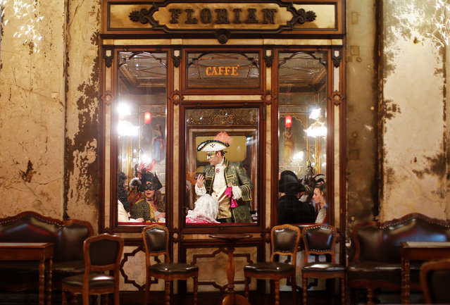 Revellers are seen at the Caffe Florian coffee shop in Saint Mark's Square during the Venice Carnival, Italy February 17, 2017. (Photo by Alessandro Bianchi/Reuters)
