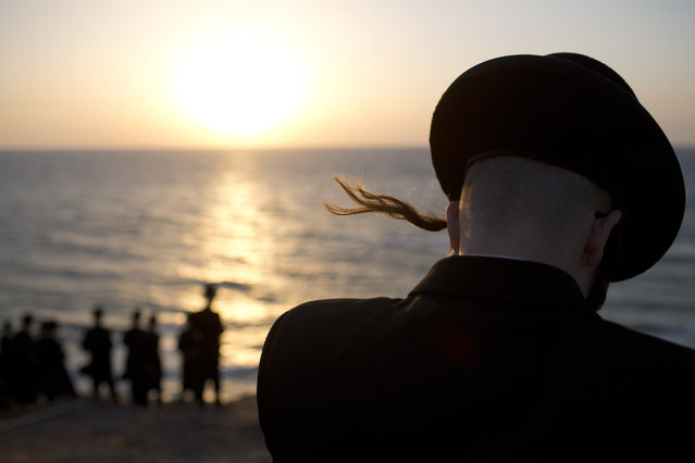 Ultra-Orthodox Jews of the Hassidic sect Vizhnitz gather on a hill overlooking the Mediterranean sea as they participate in a Tashlich ceremony in Herzeliya, Israel, Thursday, September 12, 2013. (Photo by Oded Balilty/AP Photo)