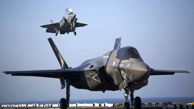 Two U.S. Marine F-35B Lightning II Joint Strike Fighters complete vertical landings aboard the USS Wasp (LHD-1) during operational testing May 18, 2015. Picture taken May 18, 2015. (Photo by Lance Cpl. Remington Hall/Reuters/U.S. Marine Corps)