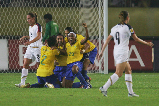 Marta (L 10#)  of Brazil celebrates the goal  during the Womens World Cup 2007 Semi Final match between USA and Brazil at Hangzhou Dragon Stadium on September 27, 2007 in Hangzhou, Zhejiang province of China. (Photo by Feng Li/Getty Images)