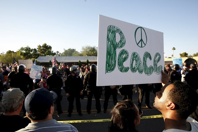 """Counter demonstrators look over to those attending the """"Freedom of Speech Rally Round II"""" outside the Islamic Community Center in Phoenix, Arizona May 29, 2015.  More than 200 protesters, some armed, berated Islam and its Prophet Mohammed outside an Arizona mosque on Friday in a provocative protest that was denounced by counterprotesters shouting """"Go home, Nazis,"""" weeks after an anti-Muslim event in Texas came under attack by two gunmen.  REUTERS/Nancy Wiechec"""