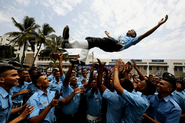Indian Air Force (IAF) newly trained Medical Assistants celebrates after passing out parade at Medical Training Centre, in Bangalore, India, 28 June 2019. Around 75 trained medical assistants of Indian Air Force officers, culmination of basic military training and professional combat skills on completion of initial Joint Basic Phase Training (JBPT-24) during their 24 weeks training course. (Photo by Jagadeesh N.V./EPA/EFE)
