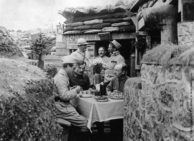 French officers dining in style in a trench near the front line, 1914