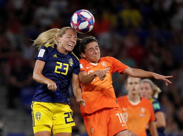 Sweden's midfielder Elin Rubensson (L) vies with Netherlands' midfielder Danielle van de Donk during the France 2019 Women's World Cup semi-final football match between the Netherlands and Sweden, on July 3, 2019, at the Lyon Stadium in Decines-Charpieu, central-eastern France. (Photo by Benoit Tessier/Reuters)