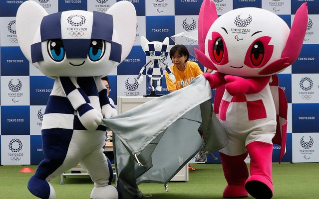 """Tokyo 2020 Olympic mascot Miraitowa (L) and Tokyo 2020 Paralympic mascot Someity (R) unveil Tokyo 2020 mascot robot Miraitowa at Tokyo Stadiuam in Chofu, on the outskirts of Tokyo, Japan, 22 July 2019. The ceremony took place prior to the """"One Year To Go Tokyo 2020"""" ceremony on 24 July 2019. The Tokyo 2020 Olympics will take place from 24 July 2020 through 09 August 2020. The Tokyo 2020 Organising Committee of the Olympic and Paralympic Games unveiled the mascot robot Miraitowa, developed by Toyota Motor Corp., on 22 July 2019. (Photo by Kimimasa Mayama/EPA/EFE/Rex Features/Shutterstock)"""
