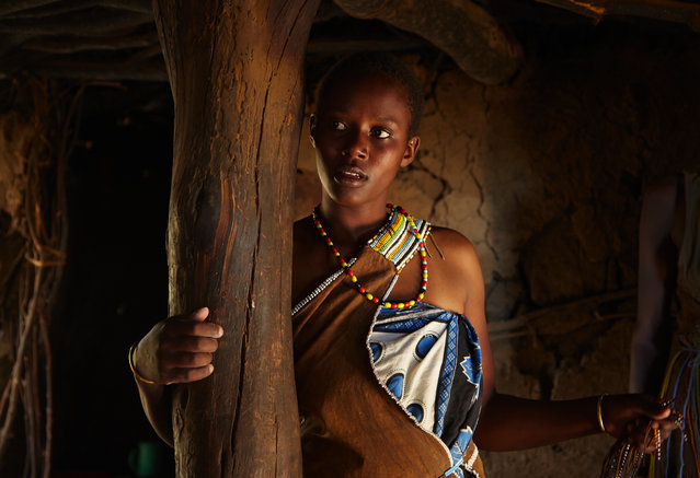 """""""The Masai tribe girl"""". This picture was taken in 05.04.2014 at Tanzania I was visiting at tag Masai tribe and it was a great honor for me to get inside their home. I met this girl there, who was a little bit shay. She didn't know to tell me her age but she told me she was born when it was raining. Photo location: Serengeti National Park, Tanzania. (Photo and caption by Keren Varon/National Geographic Photo Contest)"""