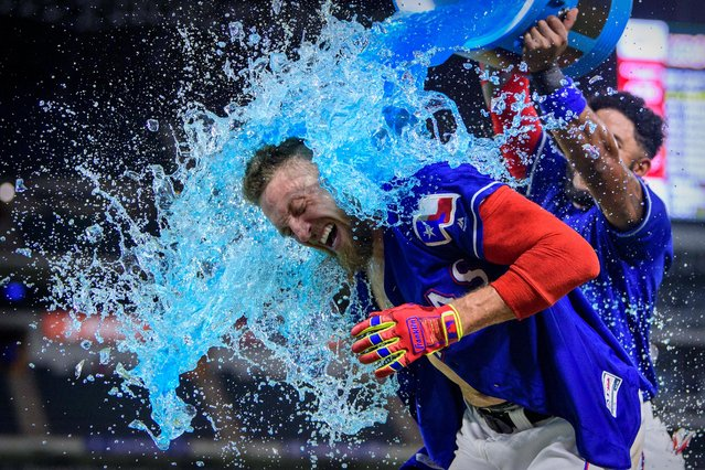 Texas Rangers designated hitter Hunter Pence is doused with Powerade by shortstop Elvis Andrus after Pence drives in Andrus for the game winning run against the Los Angeles Angels during the ninth inning at Globe Life Park in Arlington on August 22, 2019. (Photo by Jerome Miron/USA TODAY Sports)