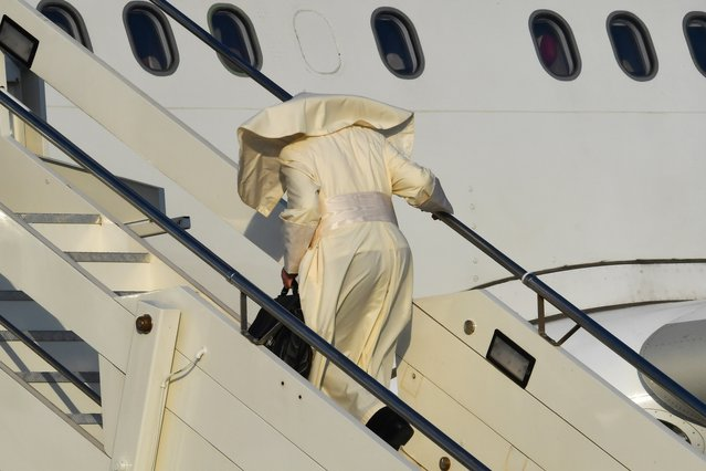 Pope Francis boards on a plane for a trip to Mozambique, Madagascar and Mauritius, at Rome's Fiumicino airport on September 4, 2019. Pope Francis arrives in Mozambique on September 4, 2019 at the start of a three-nation tour of Indian Ocean African countries hard hit by poverty, conflict and natural disaster. (Photo by Andreas Solaro/AFP Photo)