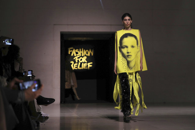 A model, wearing an outfit which has on it the image of model Kate Moss, walks the runway at the Fashion For Relief charity event in central London, Saturday, September 14, 2019. (Photo by Vianney Le Caer/Invision/AP Photo)