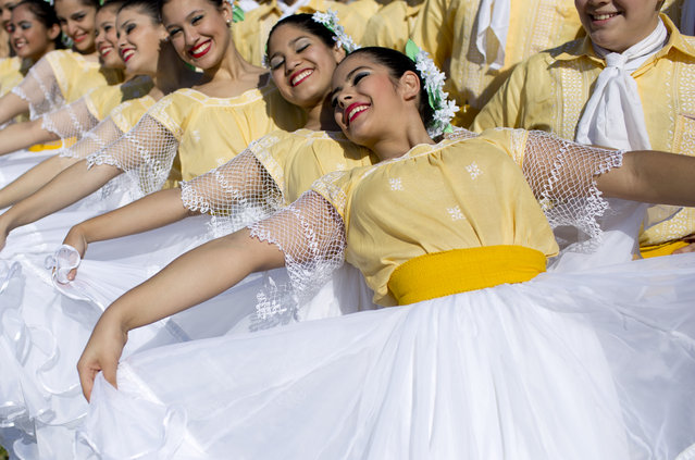 Dancers pose for a picture as they rehearse the performance they'll do during Pope Francis' visit to Asuncion, Paraguay, Thursday, July 9, 2015. The pontiff arrives to Paraguay on July 10, the last country he's visiting during his three-nation South American tour. (Photo by atacha Pisarenko/AP Photo/)